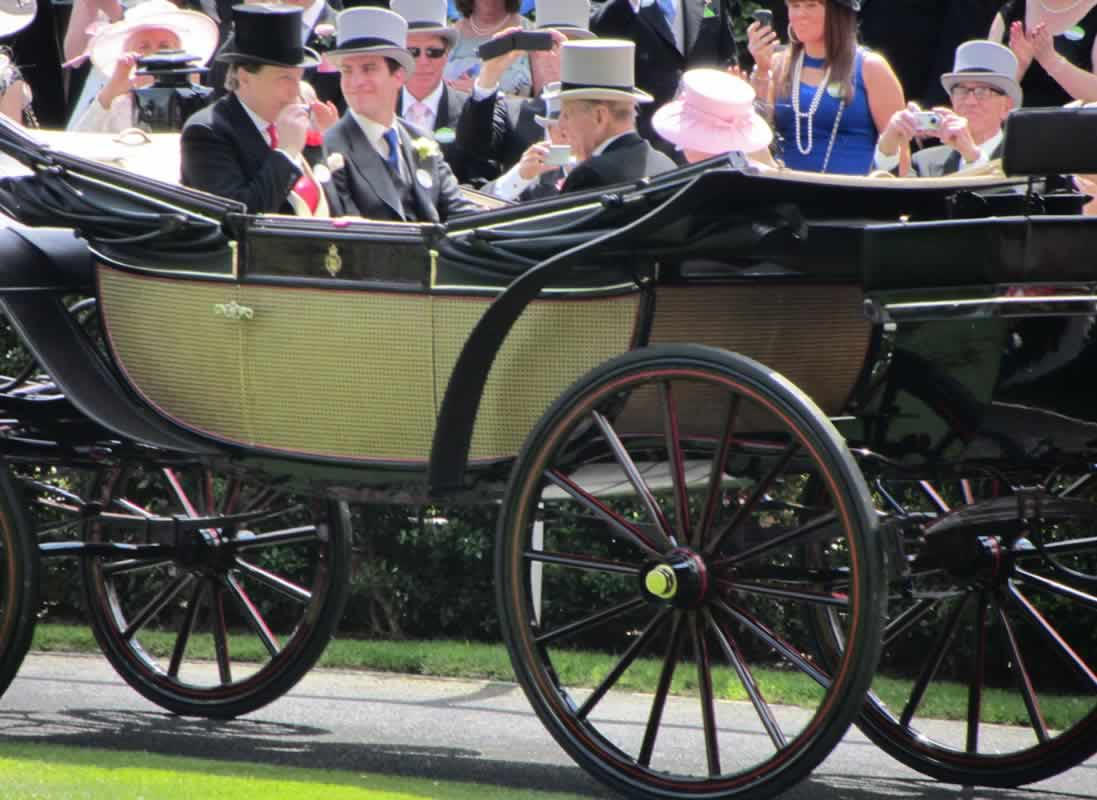 HM The Queen and (the late) Prince Philip arrive at the Epsom Derby in an open-topped horse-drawn carriage